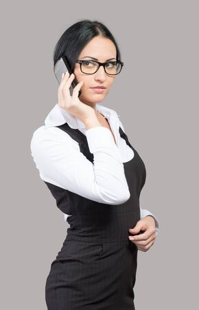 Young businesswoman talking by phone Stock Photo - 17276241