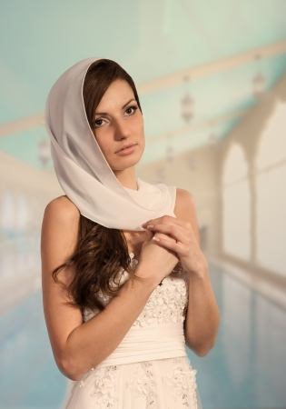 Beautiful young woman in wedding gown, Arabic style portrait Stock Photo - 17341285