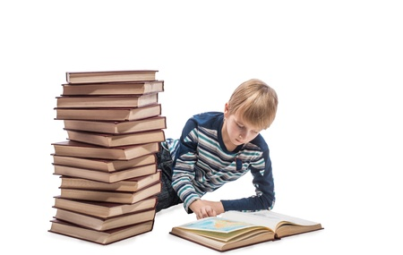 bookworm: Schoolboy lying on floor and looking at the maps in the book, white background