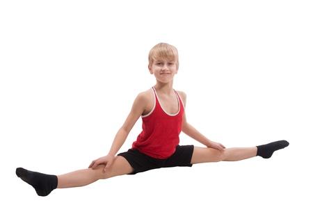 children s feet: Smiling boy doing horizontal splits, on white background