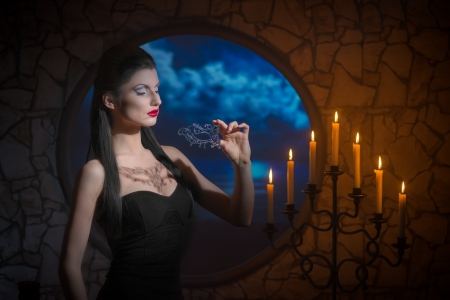 devil woman: Fantasy style portrait of demonic woman with lacy mask Stock Photo
