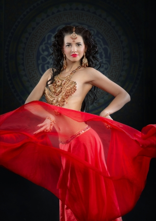Portrait of belly dancer in red costume photo
