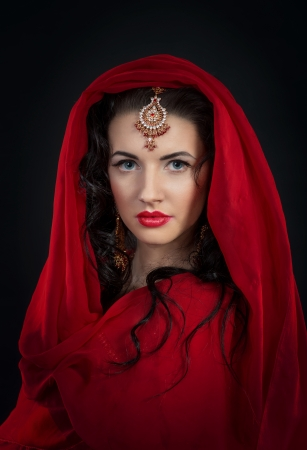 Oriental style portrait of young woman in red Stock Photo
