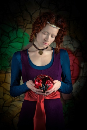 Portrait of young woman with pomegranate, stylized as old picture Stock Photo - 18812366