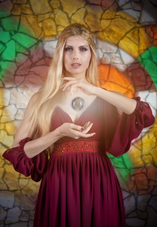 Fantasy style portrait of woman in medieval dress with the magic sphere