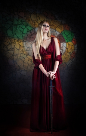 Portrait of woman in medieval dress with the sword Archivio Fotografico