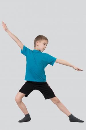 children s feet: Warming up boy on gray background