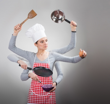 Busy housewife concept with many hands on grey background photo