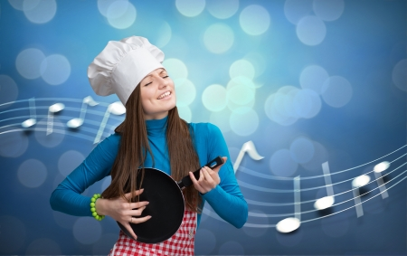 Woman in chefs hat and apron playing pan like guitar with white notes on background