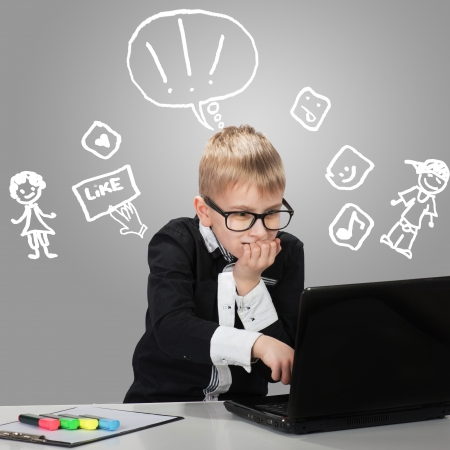 parental control: Funny boy chatting in social network with his friends Stock Photo