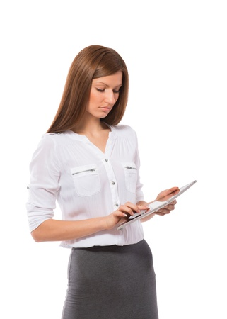 Pretty young woman touching screen on Pad Tablet PC, white background Stock Photo - 20705801
