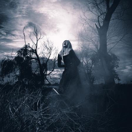 Banshee  Fantasy style portrait of a howling woman, monochromatic shot 写真素材