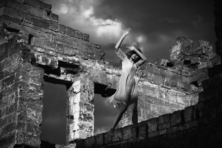 blasted: Black and white portrait of the afraid woman in the ruined building Stock Photo
