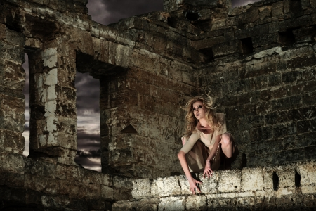 Fantasy style portrait of the scary woman in the ruins photo