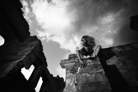 Fantasy style portrait of the scary woman in the ruins, black and white shot photo