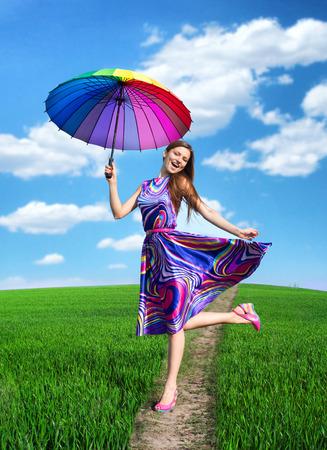 Pretty smiling woman with colorful umbrella