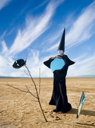 dunce cap: Strange person in black cloak with the mirror  Artwork