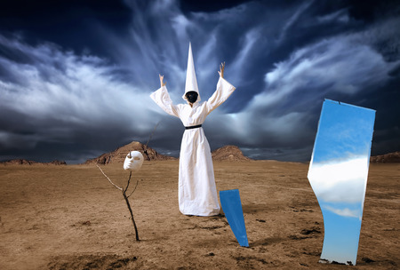 dunce cap: Strange person in white cloak with the mirrors in desert  Artwork