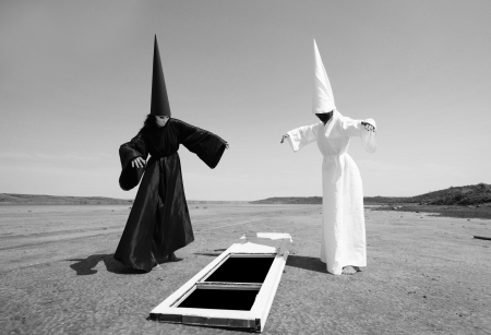 dunce cap: Strange people in black cloak and white cloak and the door to other world  Artwork