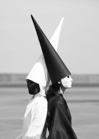 antithesis: Portrait of two strange people in black and white clothes  Artwork Stock Photo