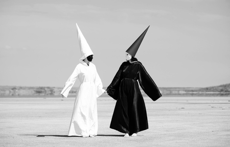 antithesis: Two strange people in black cloak and white cloak talking  Artwork
