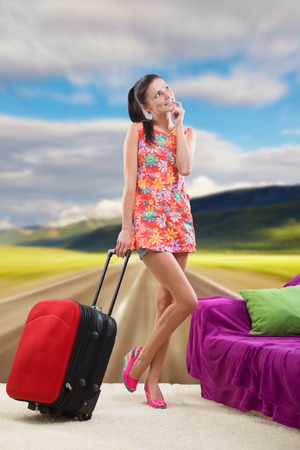 foretaste: Pretty girl planning her countryside vacation