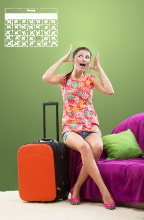 booked: Girl planning her travel during peak season, all dates are fully booked Stock Photo
