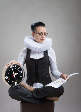 ruff: Queen of office  Business lady in ruff collar with a clock reading a document