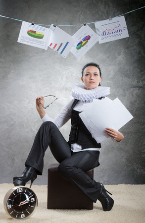 ruff: Queen of office  Business lady in ruff collar finishing a project successfully Stock Photo