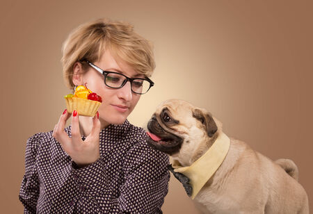 bad behavior: Pretty woman stopping her dog from eating cake