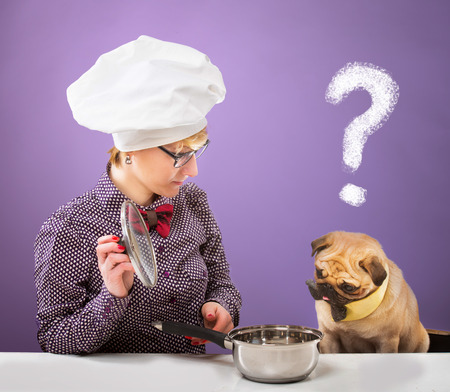 Woman in chef s hat and her dog looking at a pot with a quizzical expression, purple background
