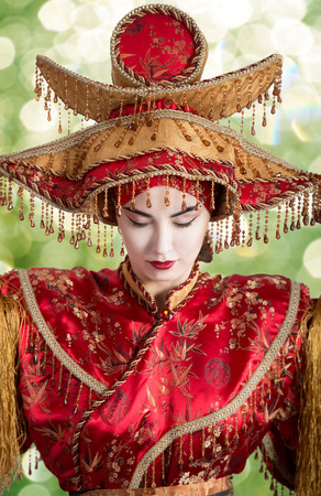 historical periods: Portrait of a woman with closed eyes in Chinese princess costume Stock Photo