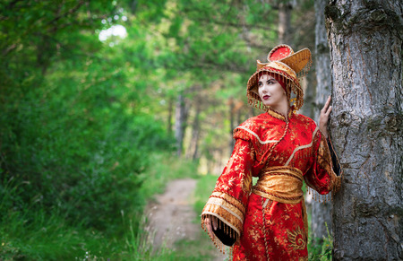chinese dress: Portrait of a woman in Chinese princess costume in the pine forest