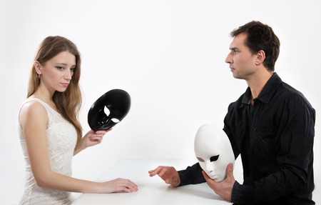 antithesis: Man and woman taking off their masks