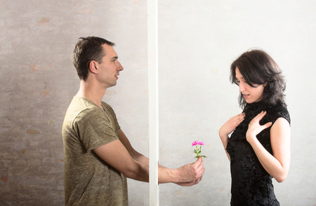 rapprochement: Breaking down the barrier between two people, concept Stock Photo