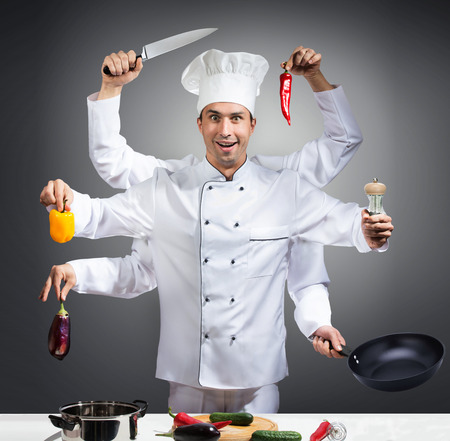 many hands: Humorous portrait of a chef with many hands, gray background