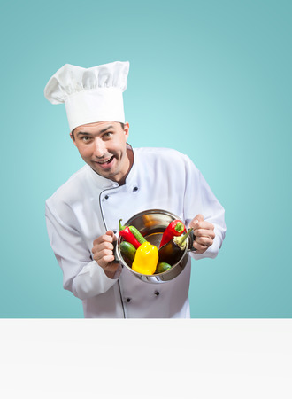 culinary skills: Humorous portrait of a chef with vegetables looking at camera