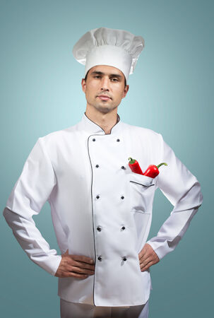 culinary skills: Chef s portrait on a blue background Stock Photo