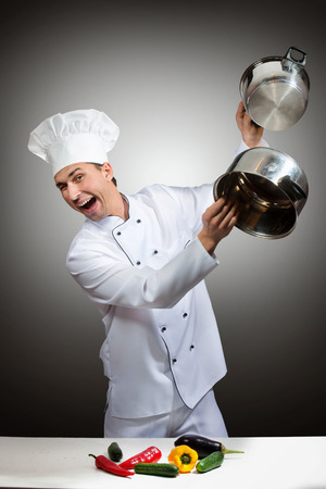 Humorous portrait of a chef beating pots Stock Photo
