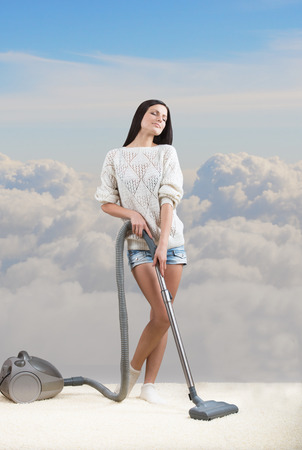 house wife: Girl dreams while she tidies up the room, cloudy sky background