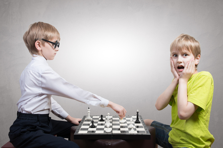 antithesis: Boy and nerd playing chess