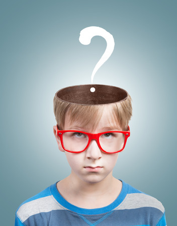 Concept of preteen boy with a question mark under his opened head photo