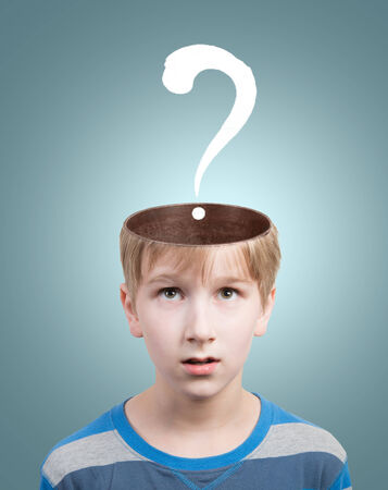 baffled: Concept of preteen boy with a question mark under his opened head