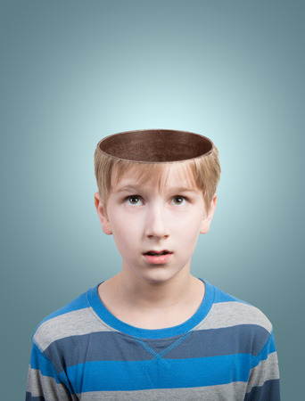 Concept of preteen boy with opened head looking at camera