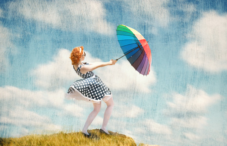 pastel shades: Retro style portrait of a girl with colorful umbrella in the wind