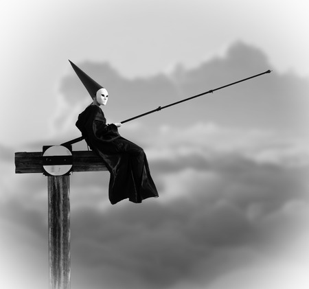 Strange person in black cloak fishing in the air. Black and white image photo