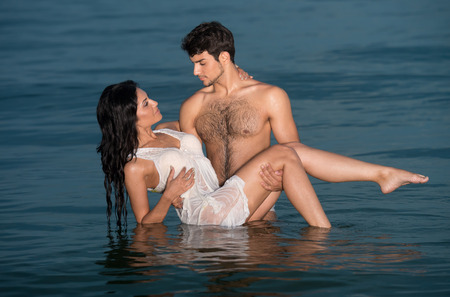hot date: Passionate young couple in water Stock Photo