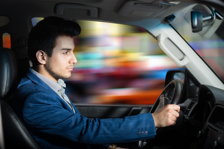 Man driving a car photo