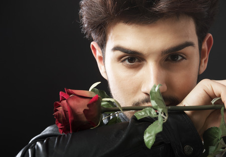 cool boys: Handsome man with a single red rose Stock Photo