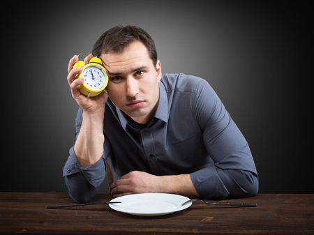 lagging: Hungry man. Slow restaurant service concept Stock Photo